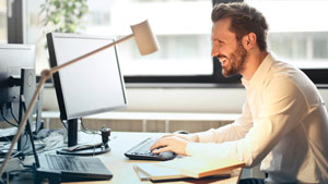 Image of a man in an office using a computer