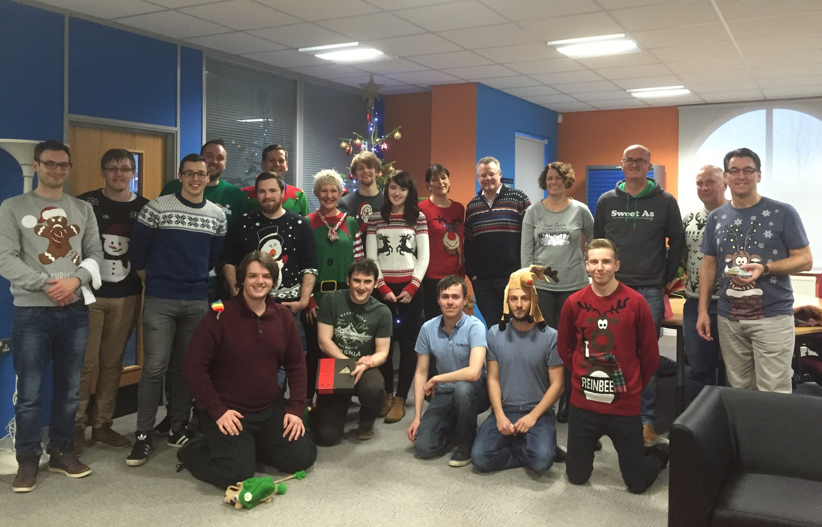 Picture of the staff at Connexica wearing Christmas jumpers