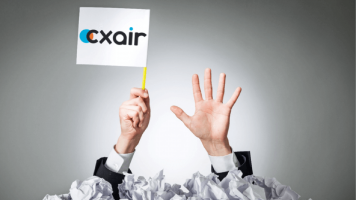 Someone holding up a white flag with CXAIR logo on it