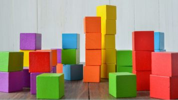 Different coloured building blocks stacked